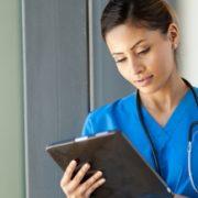 Nurse studies data analytics on iPad