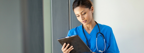 Nurse studies data analytics on iPad